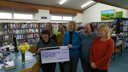 Sue James handing over the cheque for £1500